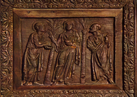 Christ breaking bread at Emmaus.