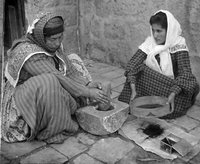 Arab women grinding coffee in Palestine..