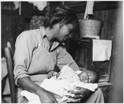 Near Buckeye, Maricopa County, Arizona. Migrant cotton picker and her baby.