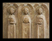 Faith, Hope, and Charity -- Bas relief sculpture of the three theological virtues.