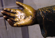 Jesus' hand reaches out to the children.