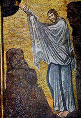 Moses receiving the Ten Commandments.